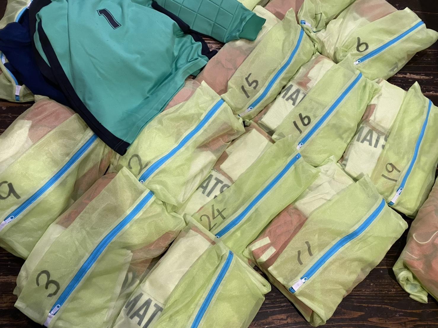 仁科松風SSさんから寄付された美しく畳まれたユニフォーム!寄付とともに文化を届けるということ
